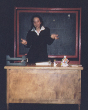 Maya Bourdeau as The Professor.